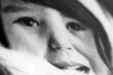 Charcoal illustration close-up of little Eskimo girl's face